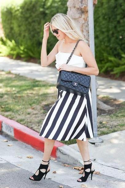 Stripes Shoes Black Modern Ensemble Blogger  Skirt Shoes Sunglasses Bag Chanel Black Bag Shoulder Bag White Strapless Stripes Black White Black Heels Lace Heels cover image