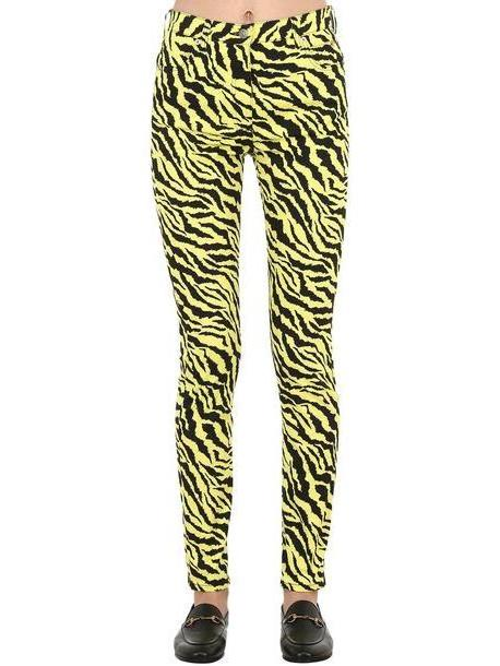 GUCCI High Rise Zebra Print Cotton Denim Jeans in black / yellow cover image