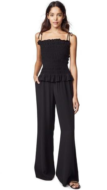 Tory Burch Smocked Jumpsuit in black cover image